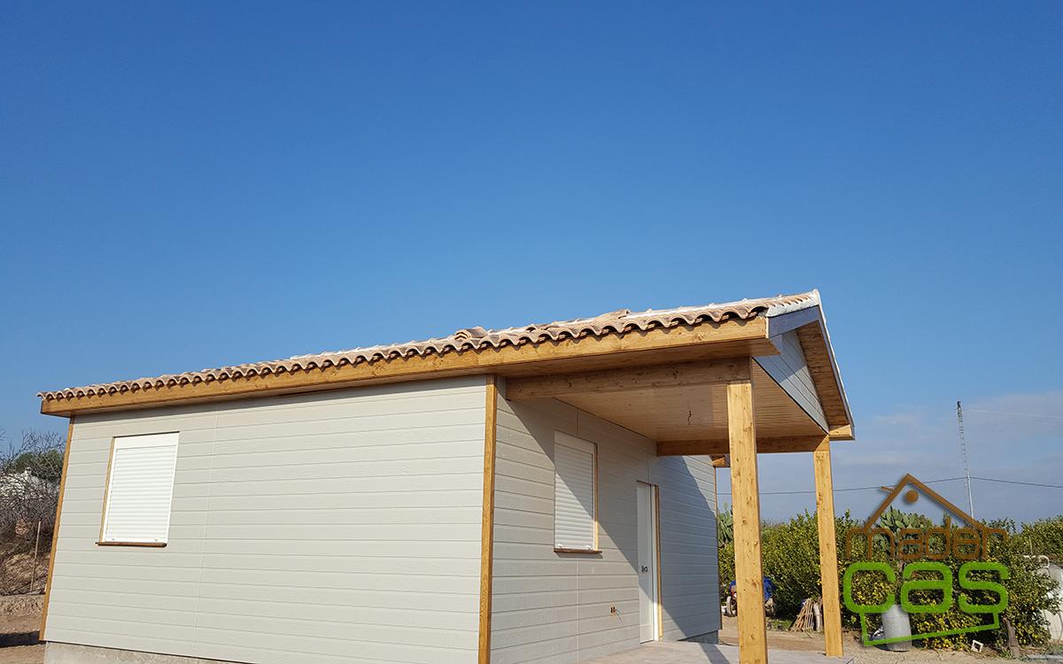 casa de madera en canexel gris